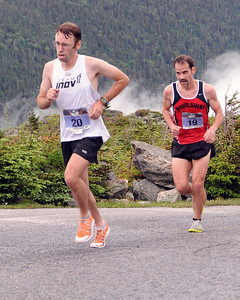 Kevin Tilton (#20), of North Conway, NH, stays ahead of Daniel Princic, of Reading, MA, during the 51st Mount Washington Road Race, which was held on Saturday, June 18th, 2011, in Pinkham Notch, NH. Runners competed on a grueling 7.6 mile course, up the Mount Washington Auto Road, finishing near the 6,288' summit, which is the highest peak in the northeastern United States.