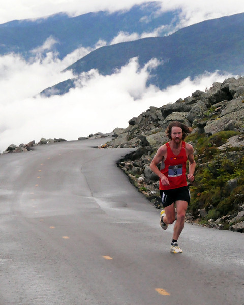 Rickey Gates, of Woody Creek, Colorado, runs high above treeline, during the 51st Mount Washington Road Race, which was held on Saturday, June 18th, 2011, in Pinkham Notch, NH. Runners competed on a grueling 7.6 mile course, up the Mount Washington Auto Road, finishing near the 6,288' summit, which is the highest peak in the northeastern United States. Mr. Gates, winner of the 2009 race, went on to win the event again, with a time of 1:01:32.