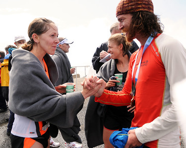 Rickey Gates (right), of Woody Creek, Colorado, winner of the 51st Mount Washington Road Race, in a time of 1:01:32, congratulates Kim Dobson, of Denver, Colorado, who just won the Women's Division, with a time of 1:12:11. The popular event was held on Saturday, June 18th, 2011, in Pinkham Notch, NH, on a grueling 7.6 mile course, up the Mount Washington Auto Road, finishing near the 6,288' summit, which is the highest peak in the northeastern United States.