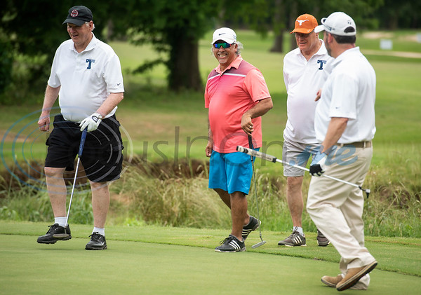 Ken Murphy, Rawley Sanchez, Charles Dodson and Mike Donley celebrate Sanchez sinking the putt during the Patriot Golf Classic Tournament at Hollytree Country Club in Tyler on Monday May 20, 2019.   (Sarah A. Miller/Tyler Morning Telegraph)