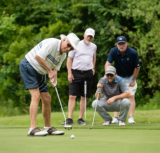 Michael Rogers of Tyler putts on No. 15 and David Smoak, Eric Horton and Cord Burnett watch during the Patriot Golf Classic Tournament at Hollytree Country Club in Tyler on Monday May 20, 2019.  (Sarah A. Miller/Tyler Morning Telegraph)