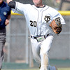 Canon City's Brandon Rix makes the throw to first after stopping a ground ball during their 4A State Baseball game against Longmont in Denver, Colorado May 21, 2012. CAMERA/MARK LEFFINGWELL