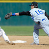 Longmont's Will Amen (right) tags out Canon City's Logan Nethercot (left)  during their 4A State Baseball game in Denver, Colorado May 21, 2012. CAMERA/MARK LEFFINGWELL