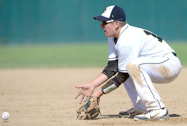 Canon City's Logan Nethercot stops a ground ball during their 4A State Baseball game against Longmont in Denver, Colorado May 21, 2012. CAMERA/MARK LEFFINGWELL