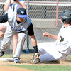 Longmont's Drew Magee (left) makes the tag on Canon City's Logan Nethercot (right) for the out during their 4A State Baseball game in Denver, Colorado May 21, 2012. CAMERA/MARK LEFFINGWELL