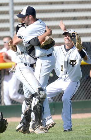 Canon City's Austin Douglas (left), Tyler Green (middle) and Matt Schwindt (right) celebrate winning their 4A State Baseball game against Longmont in Denver, Colorado May 21, 2012. CAMERA/MARK LEFFINGWELL