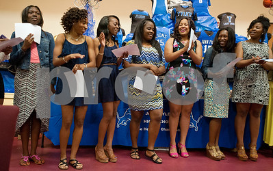 Members of the volleyball team are recognized during the John Tyler High School sports banquet Thursday night at St. Louis Baptist Church in Tyler.  (photo by Sarah A. Miller/Tyler Morning Telegraph)