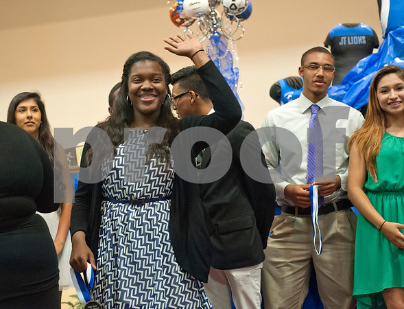John Tyler High School tennis team senior Alecia Nelson waves after receiving an award during the sports banquet Thursday night at St. Louis Baptist Church in Tyler.  (photo by Sarah A. Miller/Tyler Morning Telegraph)