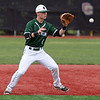 Elyria Catholic second baseman Ryan Strittmather eyes a high grounder and makes the out at first against Bay. Randy Meyers -- The Morning Journal