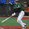 Elyria Catholic's Leighton Banjoff delivers a hit to right field against Bay. Randy Meyers -- The Morning Journal