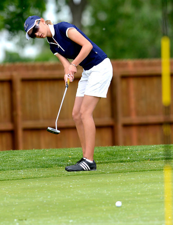 Legacy's Sarah Hankins putts on the second green during the final round of the State Golf Championship in Aurora, Colorado May 22, 2012. CAMERA/MARK LEFFINGWELL