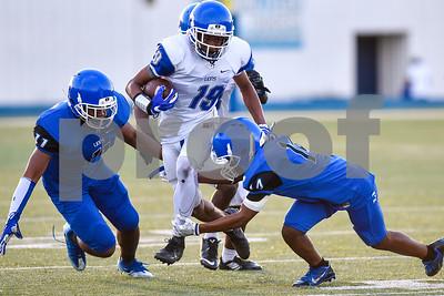 Roy Lampton (19) runs the ball through tackles during the John Tyler spring football game at John Tyler High School in Tyler, Texas, on Thursday, May 24, 2017. (Chelsea Purgahn/Tyler Morning Telegraph)
