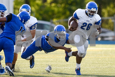 Kimbrick McCaney (35) loses his shoe as me attempts to make a tackle on Ka'Darian Asbell (26) during the John Tyler spring football game at John Tyler High School in Tyler, Texas, on Thursday, May 24, 2017. (Chelsea Purgahn/Tyler Morning Telegraph)
