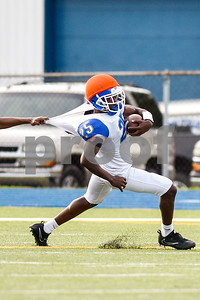 Kitan Crawford's (25) jersey is grabbed by a defensive player as he runs the ball during the John Tyler spring football game at John Tyler High School in Tyler, Texas, on Thursday, May 24, 2017. (Chelsea Purgahn/Tyler Morning Telegraph)