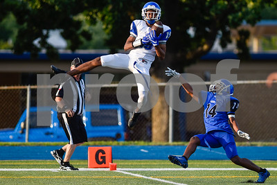 Roy Lampton (19) jumps in the air and catches the ball as he falls into the end zone to make a touchdown during the John Tyler spring football game at John Tyler High School in Tyler, Texas, on Thursday, May 24, 2017. (Chelsea Purgahn/Tyler Morning Telegraph)