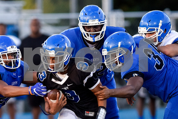 K'Lon Warren (3) is tackled by the defense during the John Tyler spring football game at John Tyler High School in Tyler, Texas, on Thursday, May 24, 2017. (Chelsea Purgahn/Tyler Morning Telegraph)