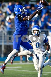 Ke'Andre Street (13) catches the ball during the John Tyler spring football game at John Tyler High School in Tyler, Texas, on Thursday, May 24, 2017. (Chelsea Purgahn/Tyler Morning Telegraph)