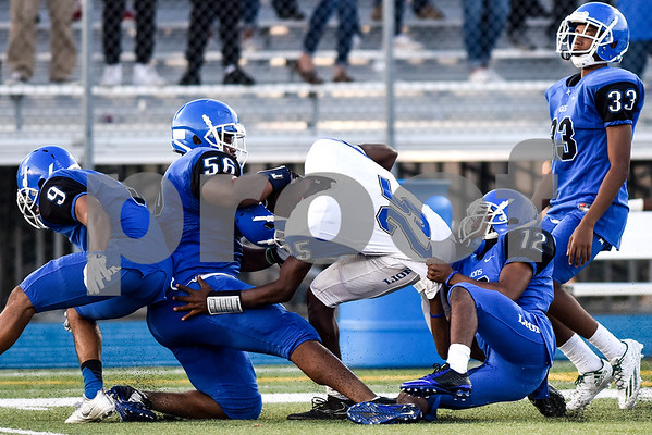 Kitan Crawford (25) is tackled by the defense during the John Tyler spring football game at John Tyler High School in Tyler, Texas, on Thursday, May 24, 2017. (Chelsea Purgahn/Tyler Morning Telegraph)