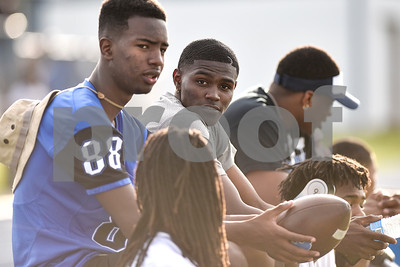 Bryson Smith, John Tyler alum and University of Houston player, sits and chats with friends during the John Tyler spring football game at John Tyler High School in Tyler, Texas, on Thursday, May 24, 2017. (Chelsea Purgahn/Tyler Morning Telegraph)