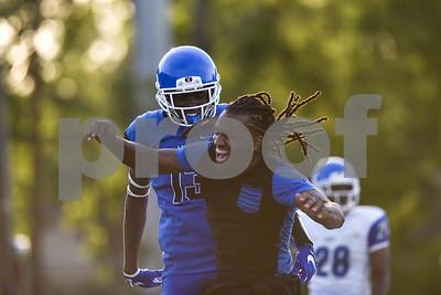 Ke'Andre Street (13) and a coach celebrate his touchdown during the John Tyler spring football game at John Tyler High School in Tyler, Texas, on Thursday, May 24, 2017. (Chelsea Purgahn/Tyler Morning Telegraph)