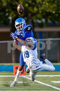 Dyvione Patterson (8) blocks Roy Lampton's (19) attempt to catch the ball during the John Tyler spring football game at John Tyler High School in Tyler, Texas, on Thursday, May 24, 2017. (Chelsea Purgahn/Tyler Morning Telegraph)