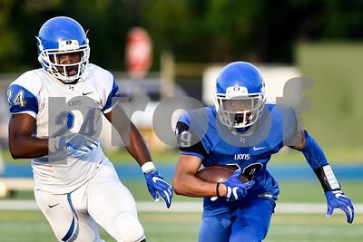 Victor Campbell Jr. (29) runs the ball during the John Tyler spring football game at John Tyler High School in Tyler, Texas, on Thursday, May 24, 2017. (Chelsea Purgahn/Tyler Morning Telegraph)