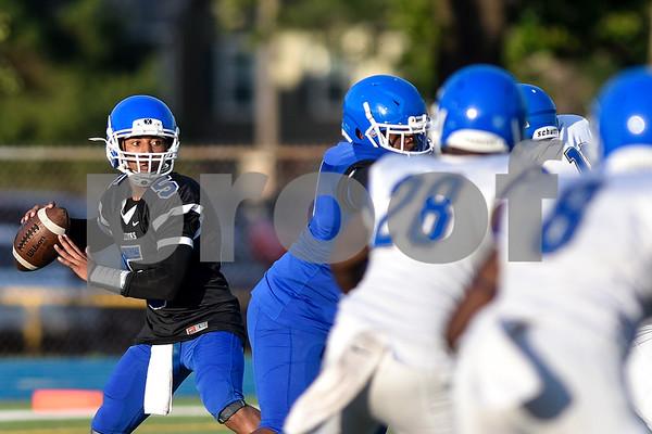 Devlen Woods (5) looks to pass the ball during the John Tyler spring football game at John Tyler High School in Tyler, Texas, on Thursday, May 24, 2017. (Chelsea Purgahn/Tyler Morning Telegraph)