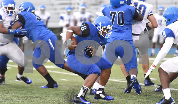 Kiante Ross carries the ball during the spring football scrimmage at John Tyler School Thursday May 26, 2016.  (Sarah A. Miller/Tyler Morning Telegraph)