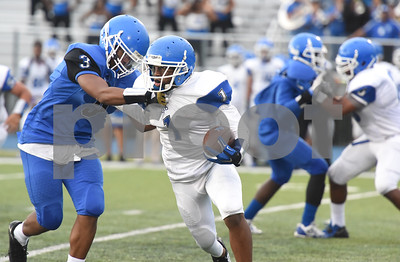 Cameron Grant (1) tries to get past Lamarcus McCowin (3) during the spring football scrimmage at John Tyler School Thursday May 26, 2016.  (Sarah A. Miller/Tyler Morning Telegraph)