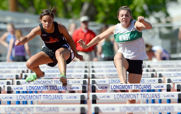 Fairview's Aurelia Casarrubras (left) and Niwot's Tyne Curran (right) run the 100 meter hurdles during the St. Vrain Invitational Longmont, Colorado May 4, 2012. BOULDER DAILY CAMERA/MARK LEFFINGWELL