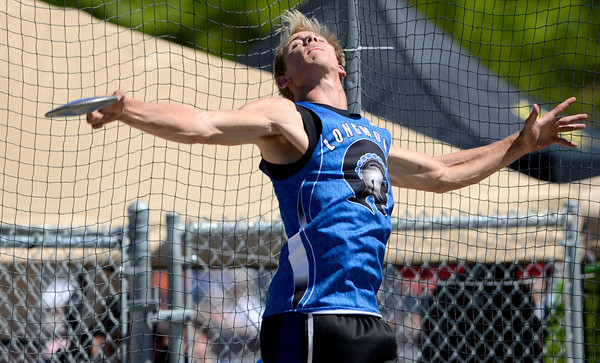 Forrest Wetterstrom, of Longmont, releases his discus during the St. Vrain Invitational Longmont, Colorado May 4, 2012. BOULDER DAILY CAMERA/MARK LEFFINGWELL