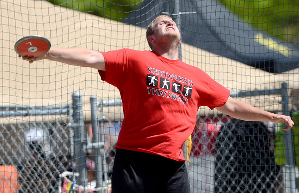 Shane Ellington, of Centaurus, lets his discus fly during the St. Vrain Invitational Longmont, Colorado May 4, 2012. BOULDER DAILY CAMERA/MARK LEFFINGWELL
