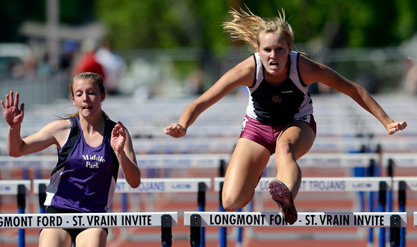 Silver Creek's Angela Mathias (right) leads Middle Parks Talise Hansen (left) in the 100 meter hurdles during the St. Vrain Invitational Longmont, Colorado May 4, 2012. BOULDER DAILY CAMERA/MARK LEFFINGWELL