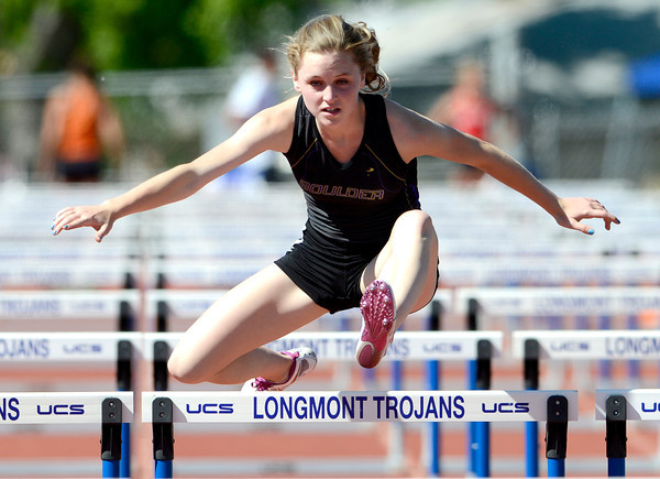 Boulder's Grace Green runs the 100 meter hurdles during the St. Vrain Invitational Longmont, Colorado May 4, 2012. BOULDER DAILY CAMERA/MARK LEFFINGWELL