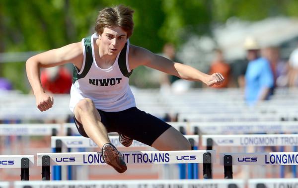 Niwot's Koen Litt runs the 110 meter hurdles during the St. Vrain Invitational Longmont, Colorado May 4, 2012. BOULDER DAILY CAMERA/MARK LEFFINGWELL