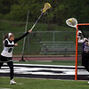 St. Joseph Academy goalie Danielle Smith clears the ball from her goal and is pressured by Ija Atanaskovic of Westlake. Randy Meyers -- The Morning Journal