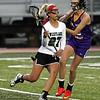 Westlake's Grace Kolonick runs the ball past Riley Justice of St. Joseph Academy. Randy Meyers -- The Morning Journal