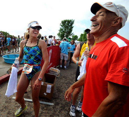 Teri Cady shares a laugh with Barry Siff, after finishing the race. She was the first woman to come in.<br /> Cliff Grassmick / June 20, 2010