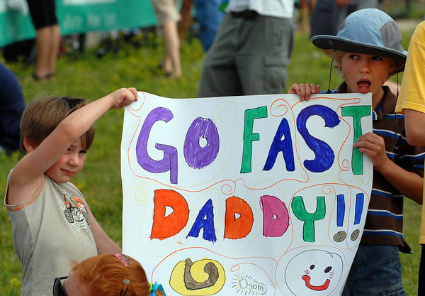 Cormac Sheridan, left, and his friend, Connor Robinson, hold  Father's Day sign for Connor's dad during the 5430 Sprint Triathlon on Sunday.<br /> Cliff Grassmick / June 20, 2010
