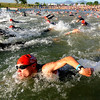 Greg Abrahamson (278), bottom, heads out with the 25-29 age group to begin the 5430 Sprint Triathlon on Sunday at the Boulder reservoir.<br /> Cliff Grassmick / June 20, 2010