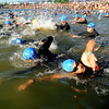 Derick Page (425), bottom,  heads out with the 35-39 age group to begin the 5430 Sprint Triathlon on Sunday at the Boulder Reservoir.<br /> Cliff Grassmick / June 20, 2010