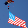 The US flag came out of the sky for the 5430 Sprint Triathlon on Sunday.<br /> Cliff Grassmick / June 20, 2010