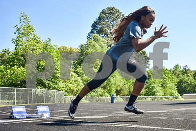 MyKaela Alfred runs at Chapel Hill High School in Tyler, Texas, on Friday, May 5, 2017. Will be competing in at state in Austin, Texas. (Chelsea Purgahn/Tyler Morning Telegraph)