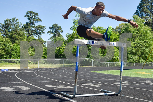 Malik Sellers jumps a hurdle at Chapel Hill High School in Tyler, Texas, on Friday, May 5, 2017. Will be competing in at state in Austin, Texas. (Chelsea Purgahn/Tyler Morning Telegraph)
