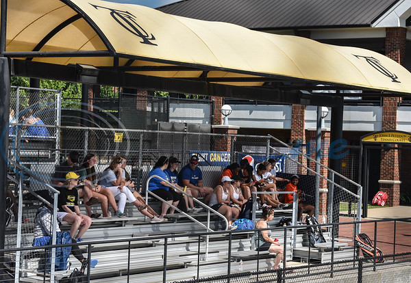 Spectators watch a match at the NJCAA National Tennis Tournament on Saturday, May 5. Several schools traveled to Tyler Junior College for the tournament which will continue through Friday, May 10. (Jessica T. Payne/Tyler Morning Telegraph)
