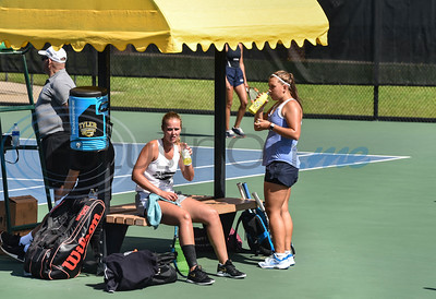 Lucie Devier (left) of TJC and Katerina Matusikova (right) of NCTC refuel during sets at the NJCAA National Tennis Tournament on Saturday, May 5. Tyler Junior College hosted the event at the JoAnn Medlock Murphy Tennis Center. (Jessica T. Payne/Tyler Morning Telegraph)