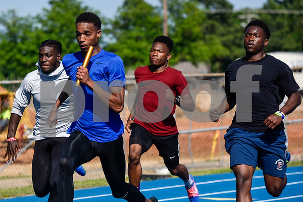 From left to right, Caleb McMiller, Ke'Tavion Humber, Michael Givens-Washington and Kitan Crawford practice the baton handoff for the 4x100 meter relay at track practice at John Tyler High School in Tyler, Texas, on Monday, May 7, 2018. The athletes will be competing in the state track meet in Austin this weekend.(Chelsea Purgahn/Tyler Morning Telegraph)