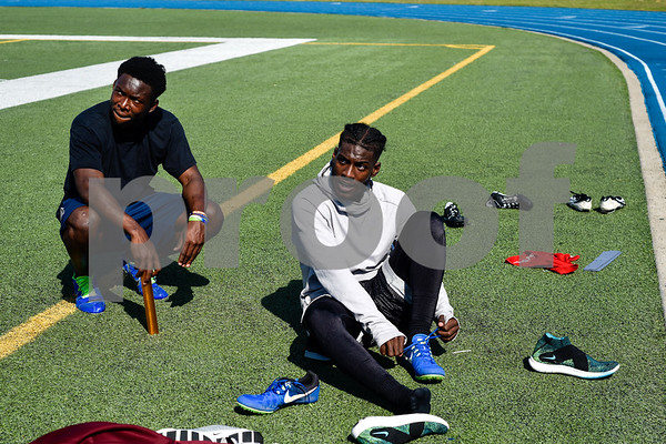 Kitan Crawford and Caleb McMiller get ready for track practice at John Tyler High School in Tyler, Texas, on Monday, May 7, 2018. The athletes will be competing in the state track meet in Austin this weekend.(Chelsea Purgahn/Tyler Morning Telegraph)