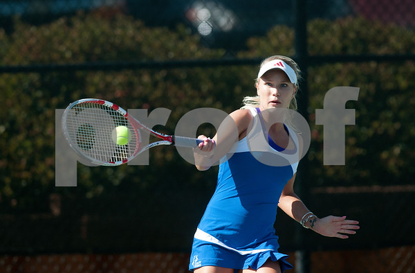 photo by Sarah A. Miller/Tyler Morning Telegraph  Simone Krog of Collin College plays a singles match against Madison Gillette of Merdian Community College Monday at the NJCAA Women's National Tennis Championship held at Tyler Junior College's JoAnn Medlock Murphy Tennis Center.