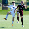 Holy Family's Josie Mitzel (left) and Berthoud's Stefani Messick (right) go for the ball during their soccer gamein Broomfield, Colorado May 8, 2012. BOULDER DAILY CAMERA/MARK LEFFINGWELL
